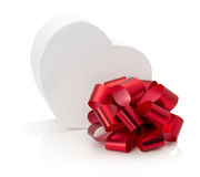Heart-shaped box with red bow isolated on the white background Stock Image