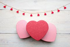 Heart shaped box with red hearts Valentines Day concept. Gift box and hearts with  on white wood background. Romantic st. Valentine`s day concept of greetings Stock Photos