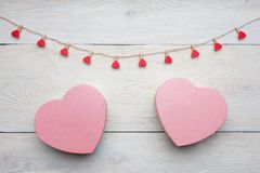 Heart shaped box with red hearts Valentines Day concept. Gift box and hearts with  on white wood background. Romantic st. Valentine`s day concept of greetings Royalty Free Stock Photo