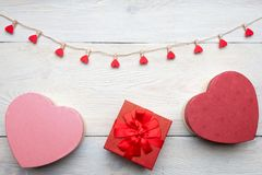 Heart shaped box with red hearts Valentines Day concept. Gift box and hearts with  on white wood background. Romantic st. Valentine`s day concept of greetings Stock Image