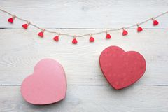 Heart shaped box with red hearts Valentines Day concept. Gift box and hearts with  on white wood background. Romantic st. Valentine`s day concept of greetings Stock Photography