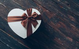 Heart Shaped Box on Wooden Background royalty free illustration
