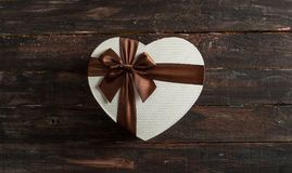 Heart Shaped Box on Rustic Wooden Background royalty free stock photography