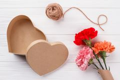 Heart shaped box, thread and flowers bouquet. stock photos