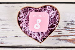 Heart-shaped box on wooden background. Royalty Free Stock Image