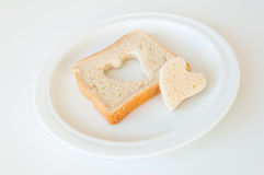 Heart shaped bread. Heart shaped white bread on a plate Stock Photography