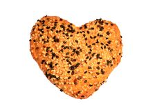 Heart shaped bread with black and white sesame seeds, isolated Royalty Free Stock Photos