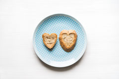 Heart-shaped bread on blue plate love concept Stock Image