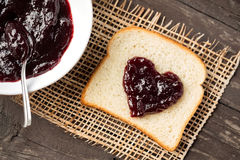 Heart shaped bread with cherry jam Stock Images