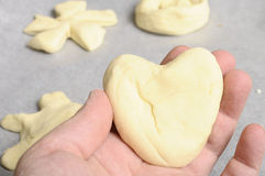 Heart-shaped Bread dough for baking Stock Images