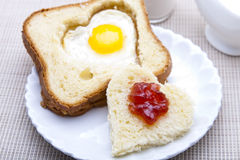 Heart shaped bread and egg Royalty Free Stock Photography