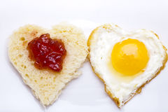 Heart shaped bread and egg Stock Images