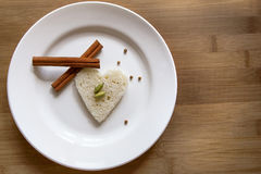 Heart shaped bread on a plate. On wood Royalty Free Stock Image