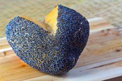 Heart shaped bread roll with poppy seeds on  wood Stock Photography