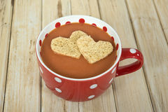 Heart shaped breads in tomato soup Royalty Free Stock Image