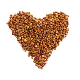 Heart shaped brown buckwheat, valentine heart of brown groats. I Stock Photos