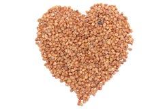 Heart shaped buckwheat isolated on white background Stock Photo