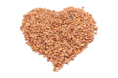 Heart shaped buckwheat isolated on white background Stock Images