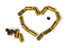 Heart shaped bullets. Isolated over white background Royalty Free Stock Photos