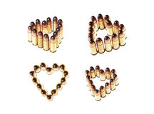 Heart shaped bullets. Isolated on white background stock photography