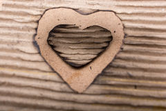 Heart shaped burnt out of a cardboard Royalty Free Stock Photos