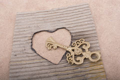Heart shaped burnt out of a cardboard Royalty Free Stock Photography