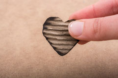Heart shaped burnt out of a cardboard Royalty Free Stock Image