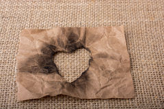 Heart shaped burnt out of a paper Royalty Free Stock Images
