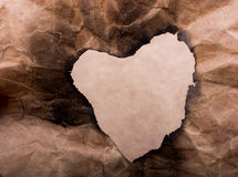 Heart shaped burnt out of a paper Royalty Free Stock Photos