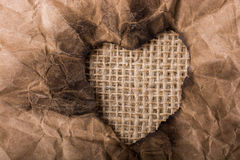Heart shaped burnt out of a paper Stock Photo