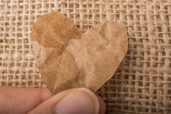 Heart shaped burnt out of paper Stock Photography