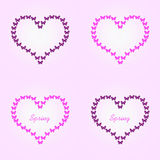 Heart shaped butterfly flight, pink and black butterflies.  Stock Image
