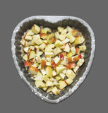 Heart shaped cake with apple Stock Image