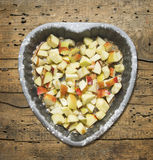 Heart shaped cake with apple on old wood Stock Images