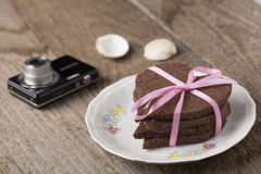 Heart-shaped cake with camera Stock Image