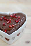 Heart shaped cake. With chocolate and pomegranate seeds Royalty Free Stock Image