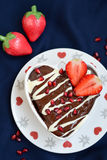 Heart shaped cake. A heart shaped cake with chocolate and strawberries Royalty Free Stock Photography