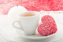 Heart-shaped cake with a cup of green tea Stock Image
