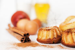 Heart-shaped cake and ingredients Stock Images
