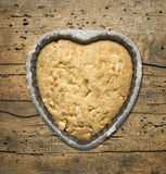 Heart shaped cake on old wooden background Royalty Free Stock Photography