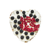Heart shaped cake with whipped cream and berries Royalty Free Stock Photos
