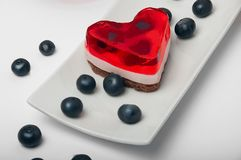 Heart-shaped cake. On white background Royalty Free Stock Photos