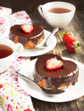 Heart shaped cakes with chocolate and strawberry Stock Photos
