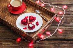 Heart-shaped cakes and cup of coffee on wooden table. Heart-shaped red cakes and cup of coffee on wooden table stock images