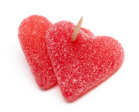 Heart-shaped candies attached by a toothpick Stock Images