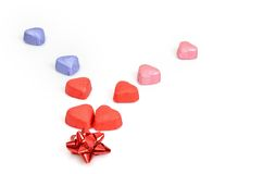 Heart shaped candies and gift Stock Images