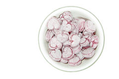 Heart shaped candies in a small bowl. On white Stock Photos