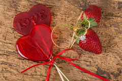 Heart shaped candies and strawberries with diamond ring Royalty Free Stock Photography
