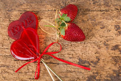 Heart shaped candies and strawberries Stock Images