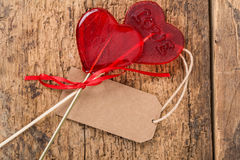 Heart shaped candies. On wooden surface Stock Photos